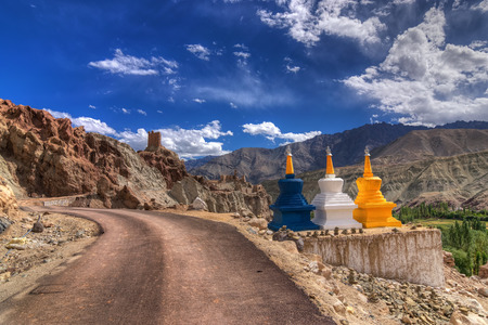 Three colourful buddhist religious stupas at Leh, Ladakh, Jammu and Kashmir, India, religious, landscape, himalayas,mountain, road, blue sky, scenery, scenic, chorten, clouds,high, road, travel, three