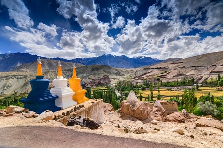 Three colourful buddhist religious stupas at Leh, Ladakh, Jammu and Kashmir, India