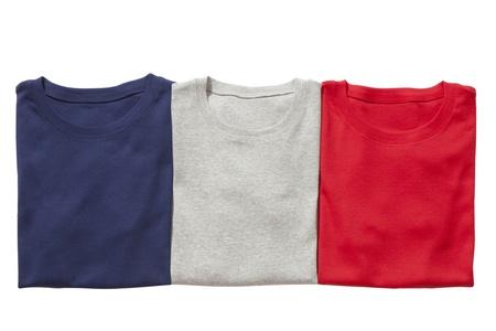 Three folded t-shirts isolated on white