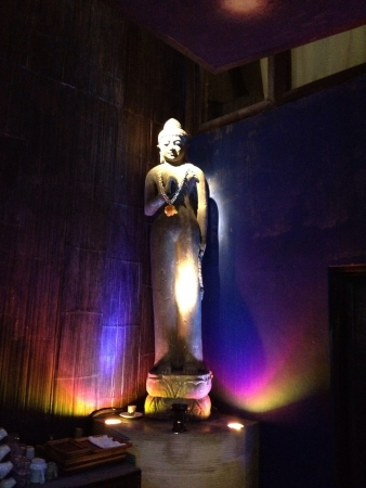 statue of the Buddha bathed in dramatic lighting