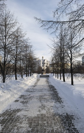 winter pavement to Romanov family sculpure to Saviour on Blood Cathedral