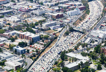 Los Angeles, USA - May 27, 2015: Aerial view of heavy traffic on Interstate 110, Santa Monica Boulevard is crossing.