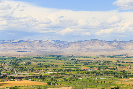 View of the Book Cliffs with the city of Fruita in Colorado in front.