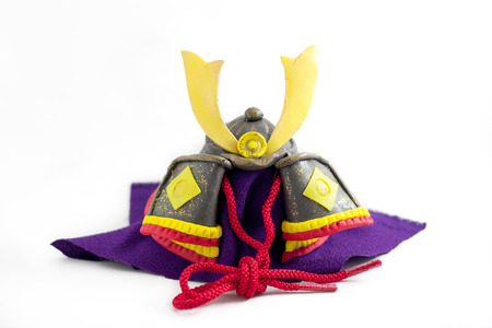 Japanese boy's day is an annual national holiday called Kodomo no hi. Japanese people celebrates it as decorating this kind of traditional helmet called Kabuto and Ayame flower.