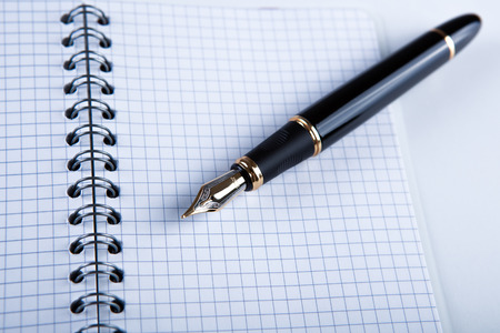 diary with fountain pen on white close-up