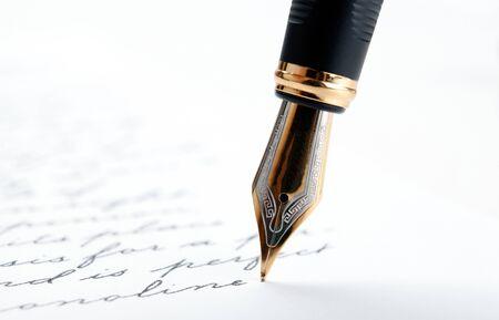 Photo pour fountain pen on paper with ink text on a white background closeup - image libre de droit