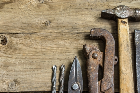 Old tools (hammer, wrench, scissors for metal)  on wooden background