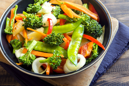 Healthy stir fried vegetables in the pan close up