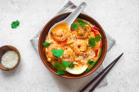 Foto de Laksa Shrimp Soup. Prawn noodle laksa soup on white background, top view, copy space. Asian Malaysian food. - Imagen libre de derechos