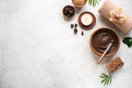 Photo pour Chocolate Spa flat lay on white background, top view, copy space. Natural spa beauty products with chocolate and plants. - image libre de droit