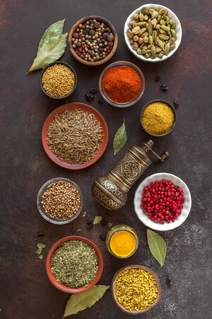 Photo pour Various Spices on dark background. Assortment, set of spices and condiments with pepper mill, top view, flat lay. Cooking food concept. - image libre de droit