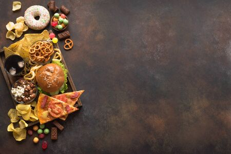 Assortment of Unhealthy Food, top view, copy space. Unhealthy eating, junk food concept.