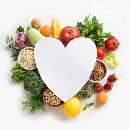 Photo pour Organic Food Background - vegan food, creative layout with heart shaped copy space. Healthy clean eating, love organic food or diet concept. - image libre de droit