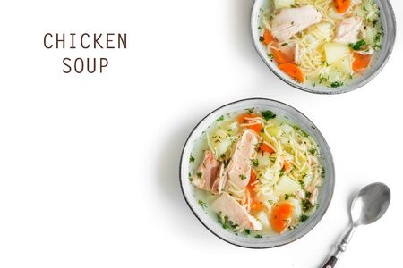 Photo pour Chicken soup with noodles and vegetables in bowl isolated on white background, top view, copy space. Homemade healthy meal - fresh chicken or turkey soup. - image libre de droit