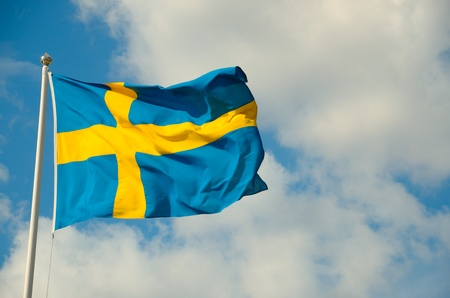 a swedish flag against blue sky