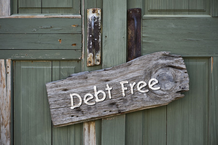 I am debt free sign on green doors.