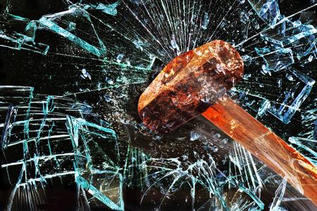 Iron hammer breaking glass window.