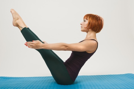 Red woman practicing fitness yoga