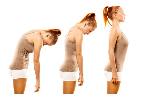 Young woman practicing yoga spine roll