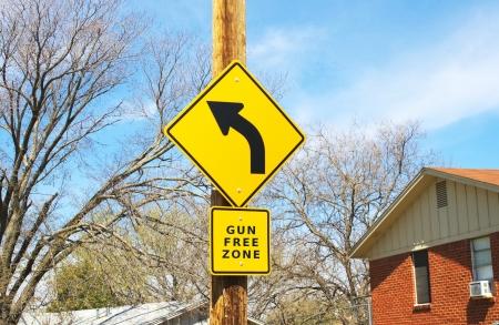 Road sign stating gun free zone