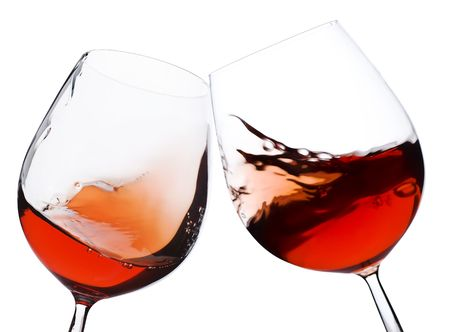 Photo pour pair of moving wine glasses over a white background, cheers! - image libre de droit
