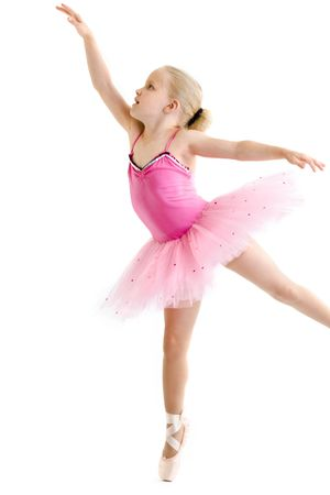 Young ballerina standing on pointe in toe shoes