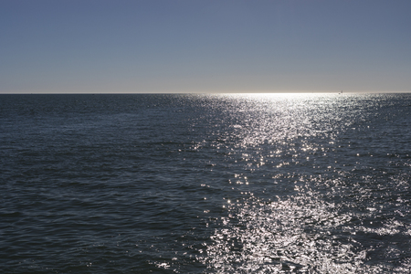 Horizon view over Atlantic Ocean from Jard sur Mer in Vendee, France with reflection of sun light over the water