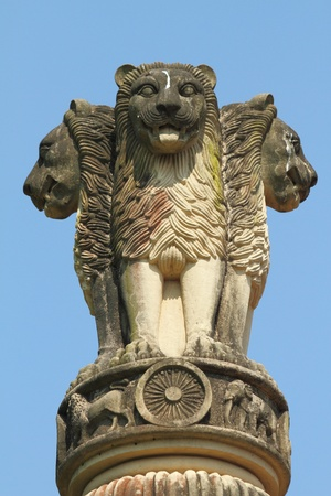 sculpture of emblem of India, four lions (one hidden from view) - symbolizing power, courage, pride and confidence - rest on a circular abacus,park in Malabar Hill, Mumbai