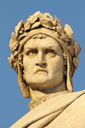 head of Dante Alighieri, famous italian poet,  detail of marble monument in Piazza Santa Croce, Florence, Italy