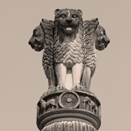 sculpture of emblem of India, four lion  symbolizing power, courage, pride and confidence - rest on a circular abacus, park in Malabar Hill, Mumbai, India, Asia