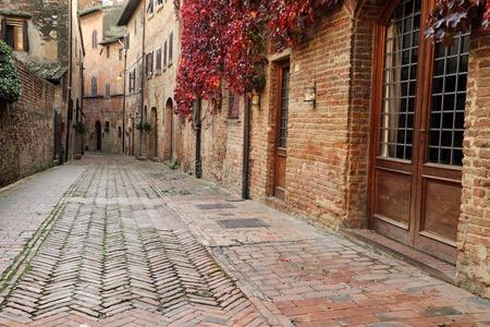 picturesque quiet brick alley in small town Certaldo Alto, Tuscany, Italy