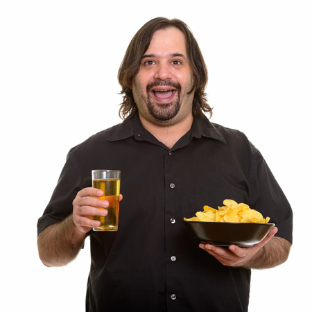 Foto für Happy fat bearded Caucasian man smiling while holding bowl of ch - Lizenzfreies Bild