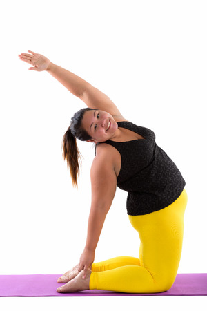 Foto für Studio shot of young happy fat Asian woman smiling while doing y - Lizenzfreies Bild