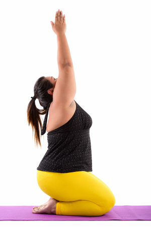 Foto für Studio shot of young fat Asian woman sitting while doing yoga po - Lizenzfreies Bild