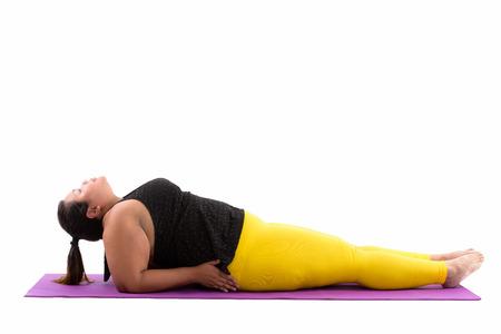 Foto für Studio shot of young fat Asian woman lying down and doing yoga p - Lizenzfreies Bild