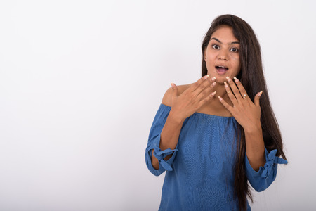 Photo for Studio shot of young Indian woman looking shocked with covering - Royalty Free Image