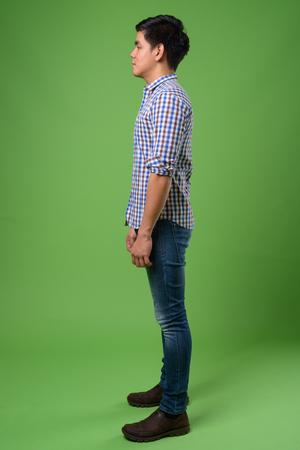 Photo pour Young handsome Filipino man against green background - image libre de droit
