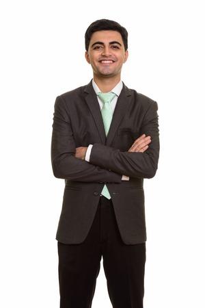 Photo pour Young handsome Persian businessman looking at camera - image libre de droit