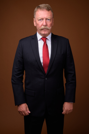 Photo for Handsome senior businessman wearing suit and tie - Royalty Free Image