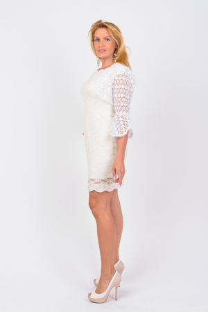 Photo for Full body shot profile view of mature businesswoman - Royalty Free Image
