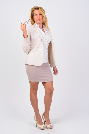 Portrait of mature businesswoman against white backgroundの写真素材