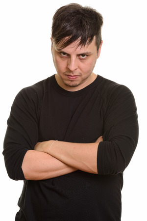 Foto für Studio shot of angry Caucasian man with arms crossed - Lizenzfreies Bild