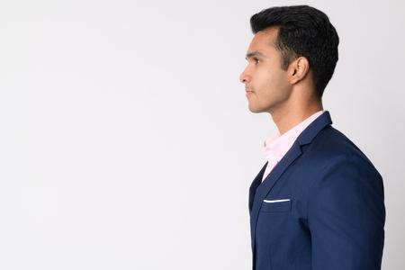 Photo pour Profile view of young handsome Indian businessman in suit - image libre de droit