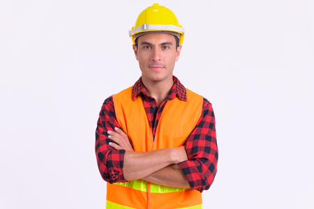 Photo pour Young handsome Hispanic man construction worker with arms crossed - image libre de droit