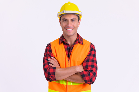 Photo pour Young happy Hispanic man construction worker smiling with arms crossed - image libre de droit