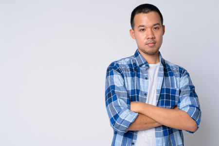 Photo for Portrait of young Asian hipster man with arms crossed - Royalty Free Image