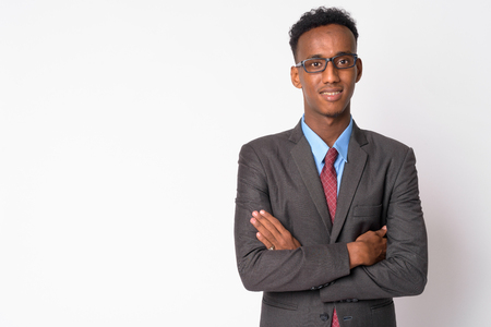 Young happy African businessman with eyeglasses smiling