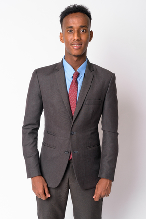 Photo for Portrait of young happy African businessman in suit smiling - Royalty Free Image