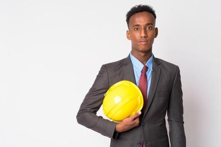 Photo pour Portrait of young handsome African businessman with hardhat - image libre de droit