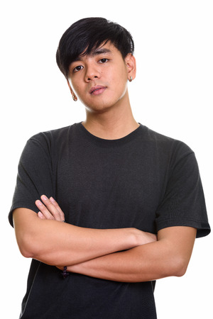 Photo for Studio shot of cool handsome Asian man with arms crossed - Royalty Free Image
